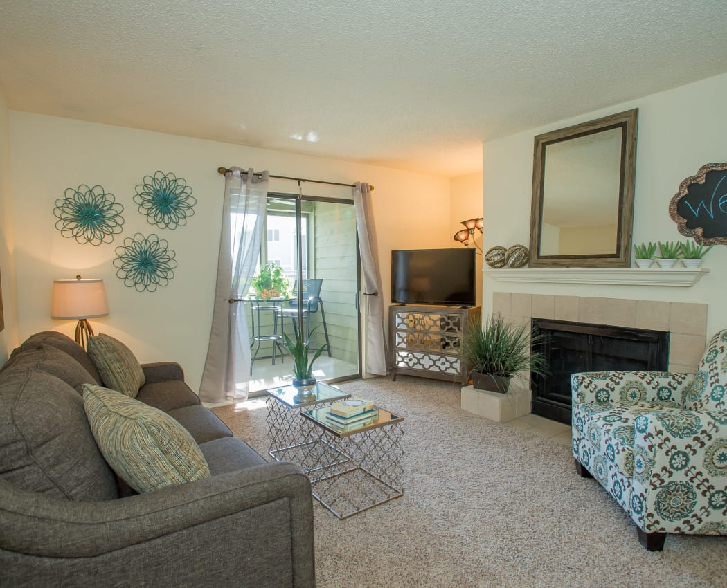 Well-lit living room at Sugarberry Apartments in Tulsa, Oklahoma