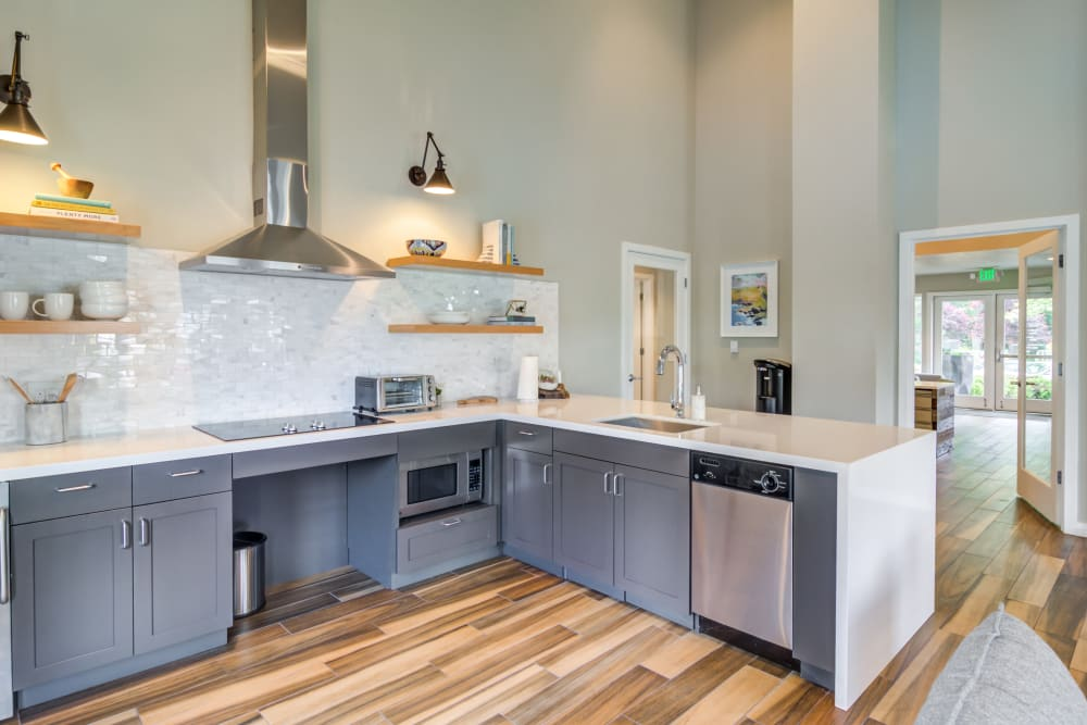 Well-equipped demonstration kitchen in the resident clubhouse at Heatherbrae Commons in Milwaukie, Oregon