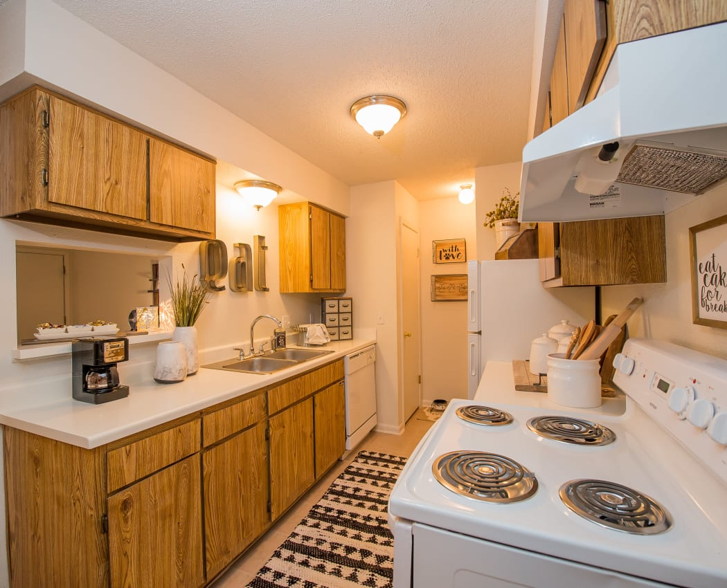 Kitchen with white appliances at Waters Edge in Oklahoma City, Oklahoma