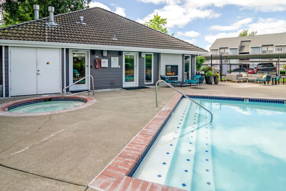 Resident clubhouse with view of the swimming pool area at Heatherbrae Commons in Milwaukie, Oregon