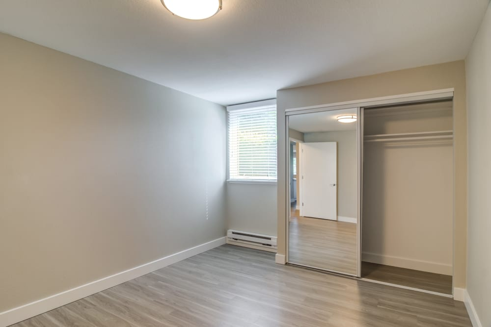 Spacious master bedroom with plenty of natural light in model home at Heatherbrae Commons in Milwaukie, Oregon