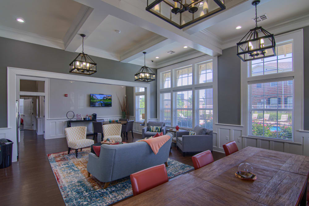Resident clubhouse seating area with TV at Traditions at Westmoore in Oklahoma City, Oklahoma.