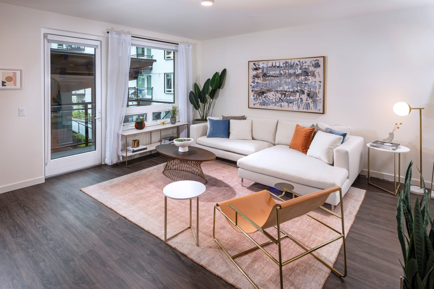 Model living room with large windows at Nightingale in Redmond, Washington