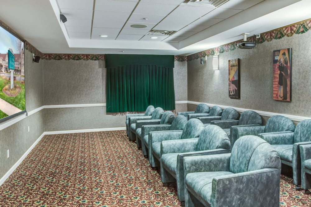 Deluxe movie theatre with comfy seating at Grand Victorian of Sycamore in Sycamore, Illinois