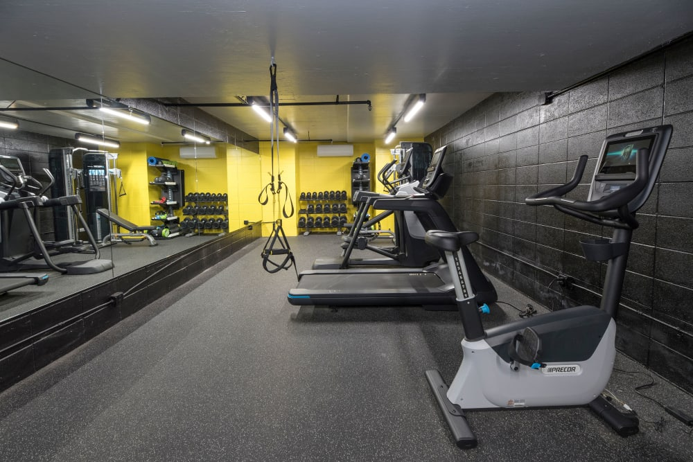 Modern fitness center with individual workout stations at Tower Apartment Homes in Alameda, California