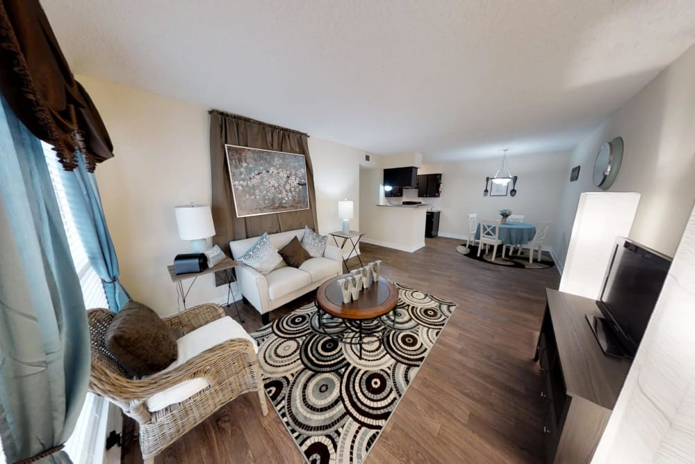 Westwood Village Apartments living room with hardwood floors in Rosenberg, TX