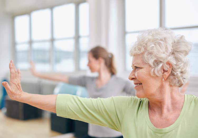 Seniors practicing yoga at Dale Commons in Modesto, California
