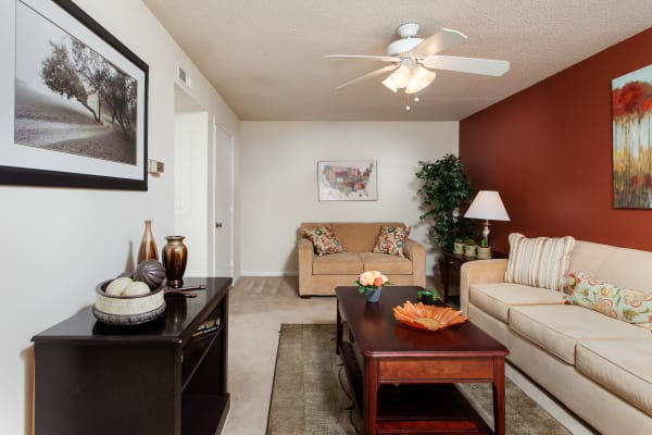 A beautifully decorated living room at Cross Creek Cove Apartments & Townhomes in Fayetteville, North Carolina