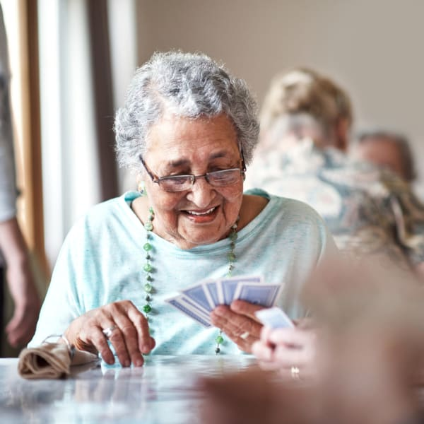 A resident playing cards at Pacifica Senior Living Sterling in Sterling, Virginia