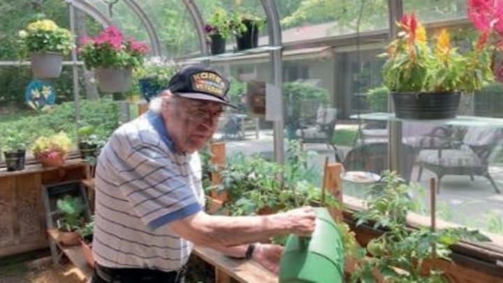 resident gardening at community