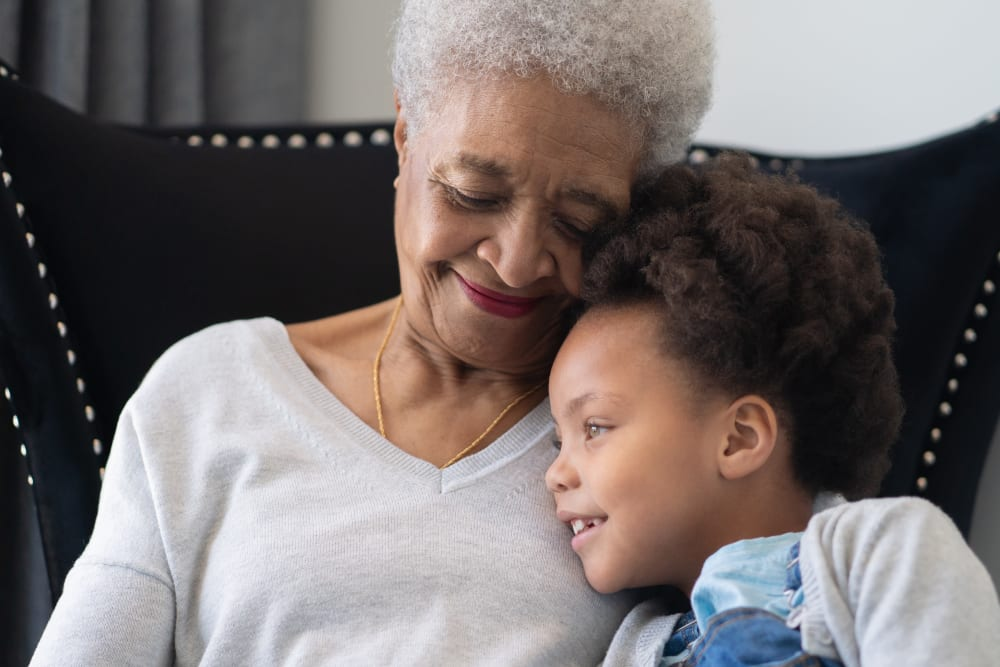 A resident with her granddaughter at Regency Palms Colton in Colton, California.