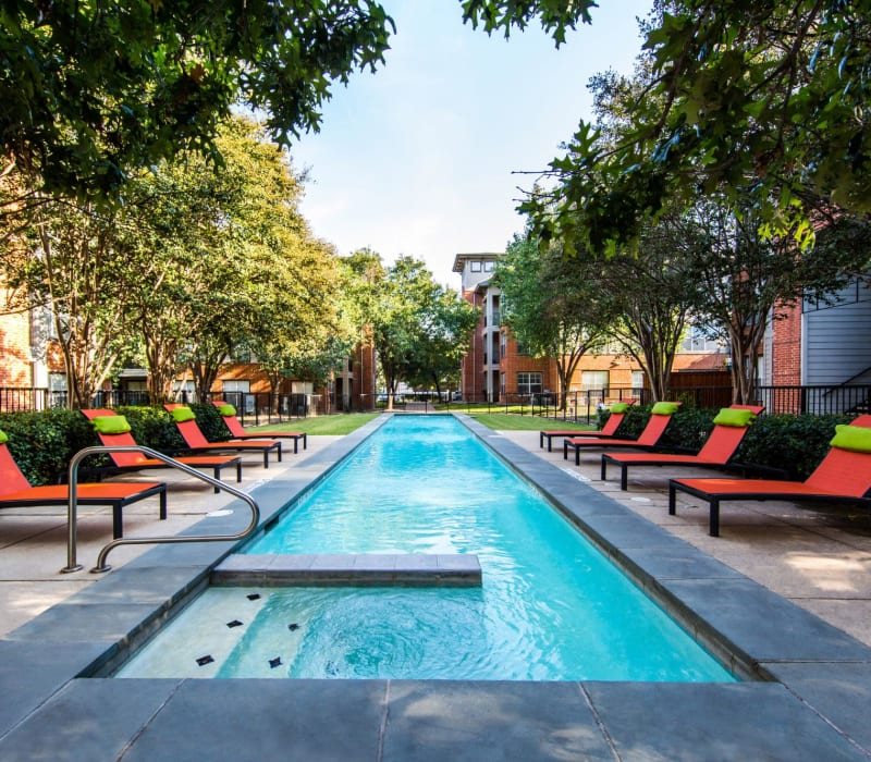 Lap pool with modern lounge chairs at Marquis on Gaston in Dallas, Texas