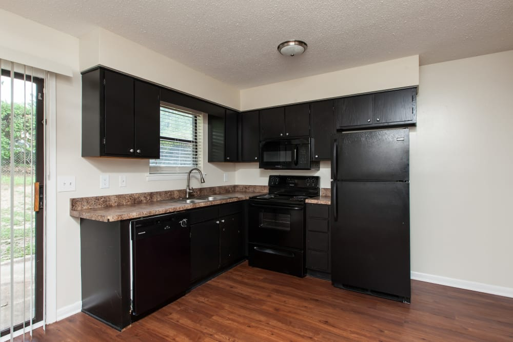 Empty kitchen layout at Cross Creek Cove Apartments & Townhomes