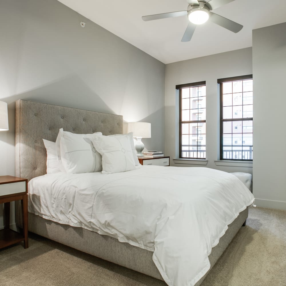 Bedroom with a ceiling fan at Cantabria at Turtle Creek in Dallas, Texas