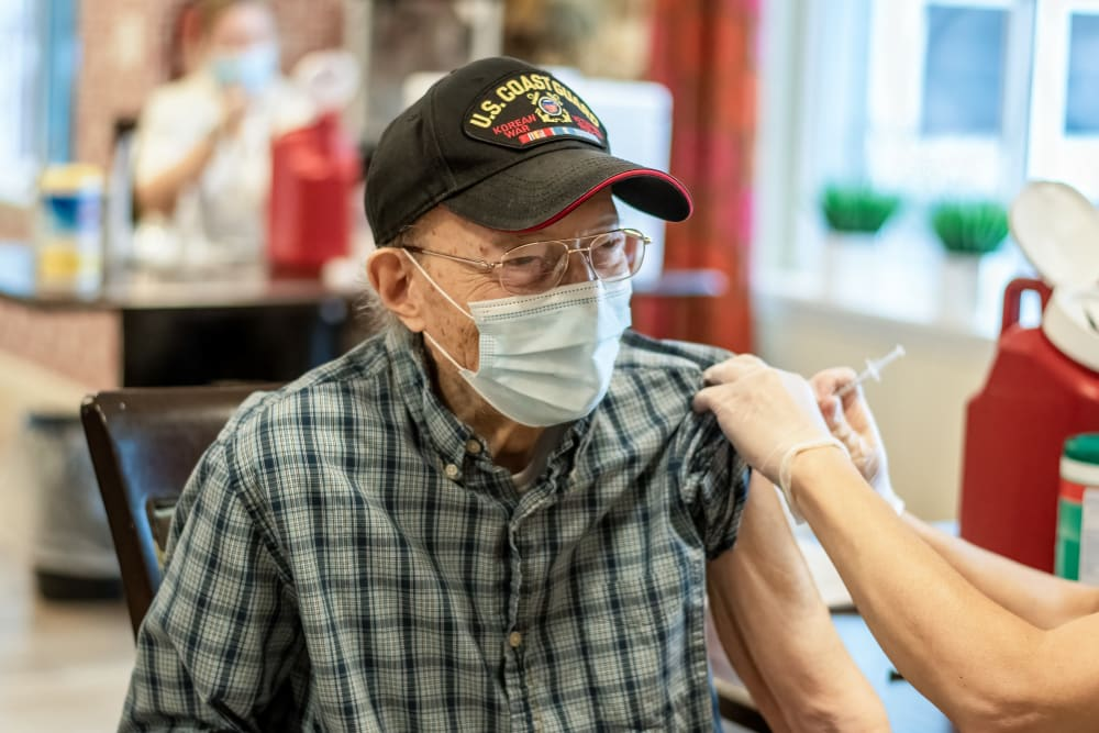 senior resident receiving a vaccine
