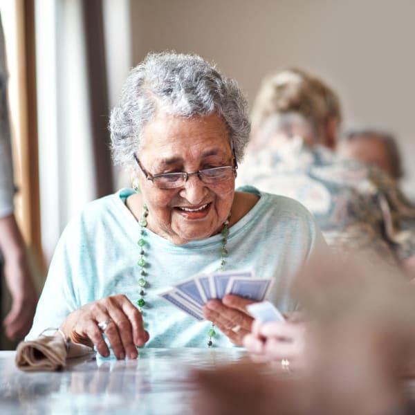 Resident playing cards at Chesapeake Place Senior Living in Chesapeake, Virginia.