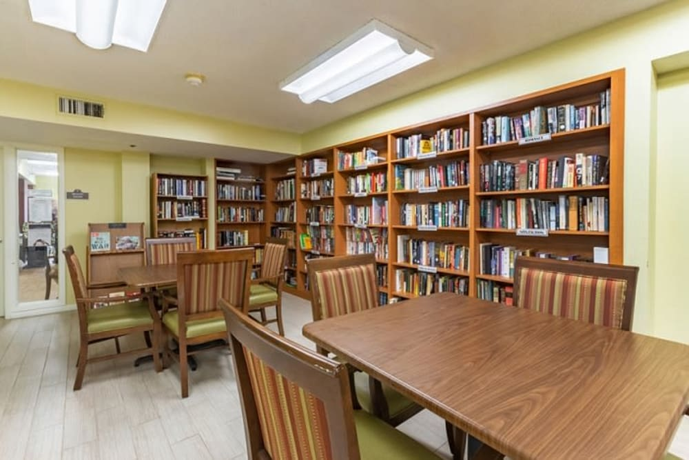 A well stocked library for residents at Grand Villa of Sarasota in Sarasota, Florida