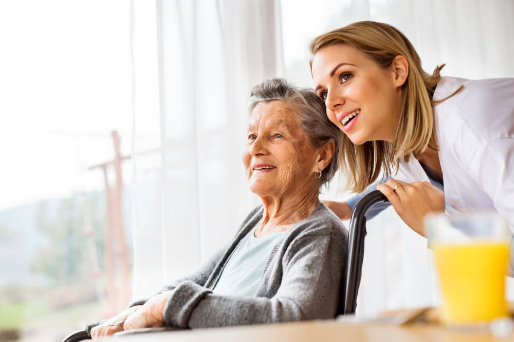 A senior resident looking on with a younger woman at her side at Regency Palms Colton in Colton, California.