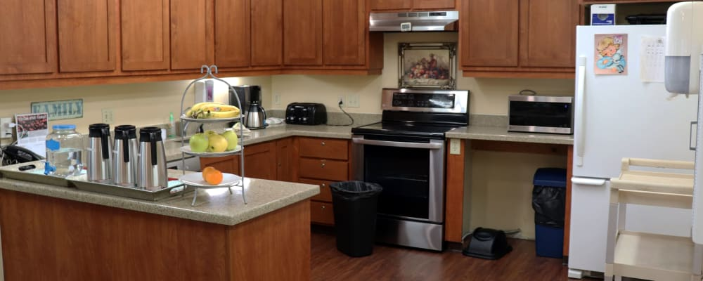 Kitchen in upscale senior living apartment with wood cabinetry at The Springs at Willowcreek in Salem, Oregon