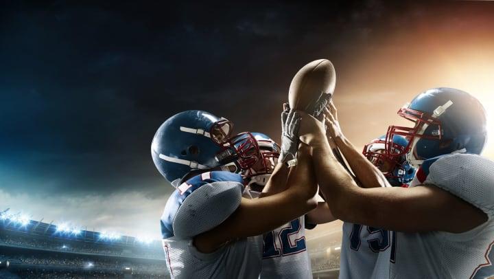 Football teammates raise football together.