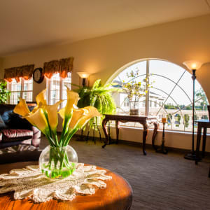 sunlit lounge with a large semicircular window at The Spring at Silverton in Fort Worth, Texas