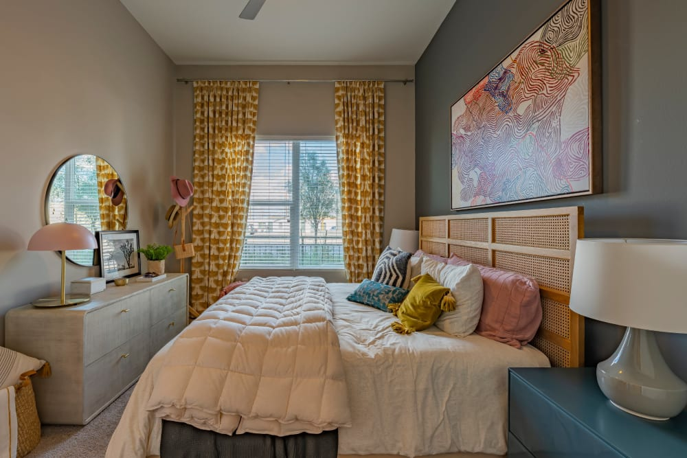 Cozy bedroom with a large window at The Tessera in Phoenix, Arizona