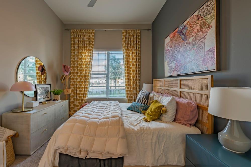 Cozy bedroom with a large window at Encore Tessera in Phoenix, Arizona