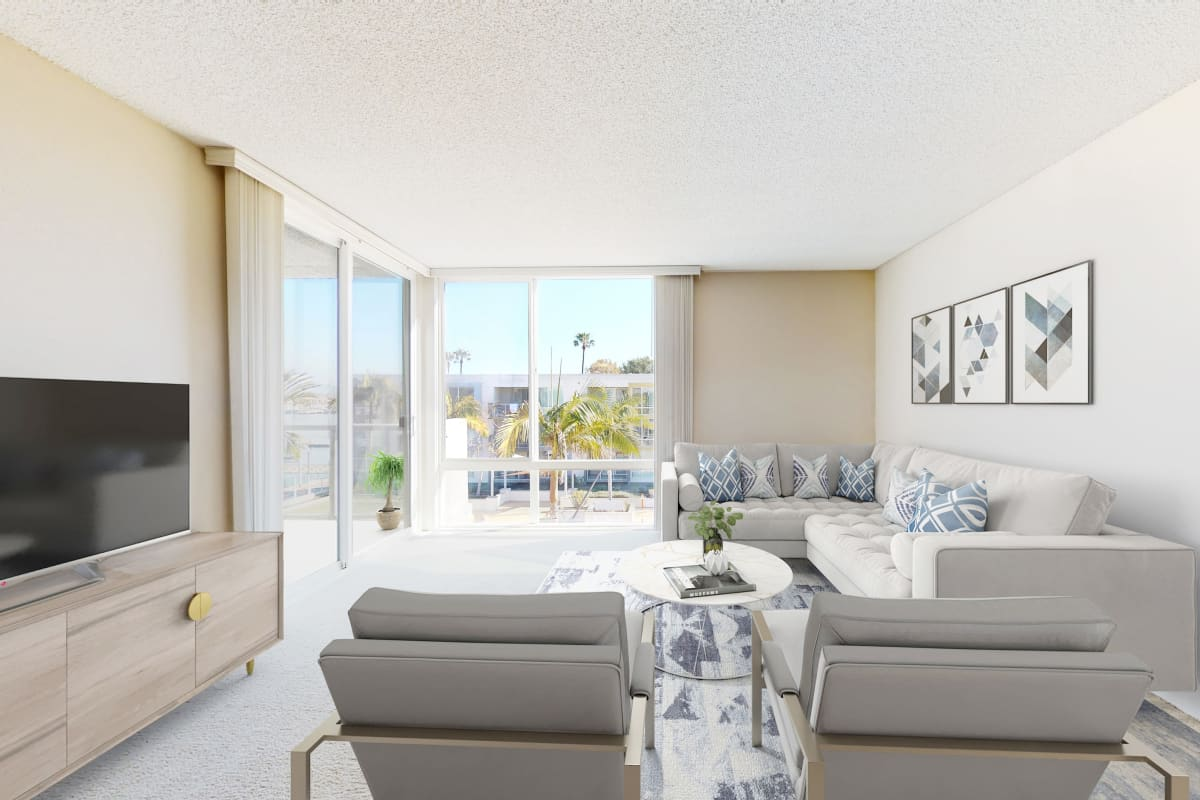 Open-concept living room with floor-to-ceiling windows at Waters Edge at Marina Harbor in Marina del Rey, California