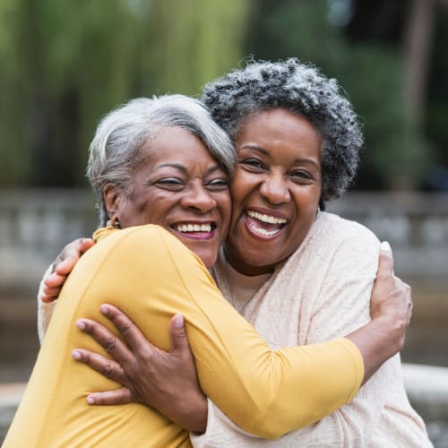 Two residents hugging at The Crossings at Eastchase in Montgomery, Alabama