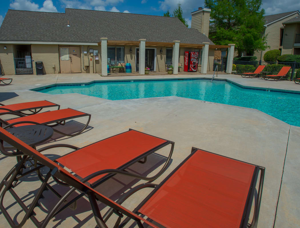 Poolside seating at Cimarron Trails Apartments in Norman, Oklahoma