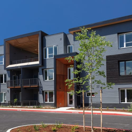 Exterior building and parking lot at Brookside Apartments in Gresham, Oregon