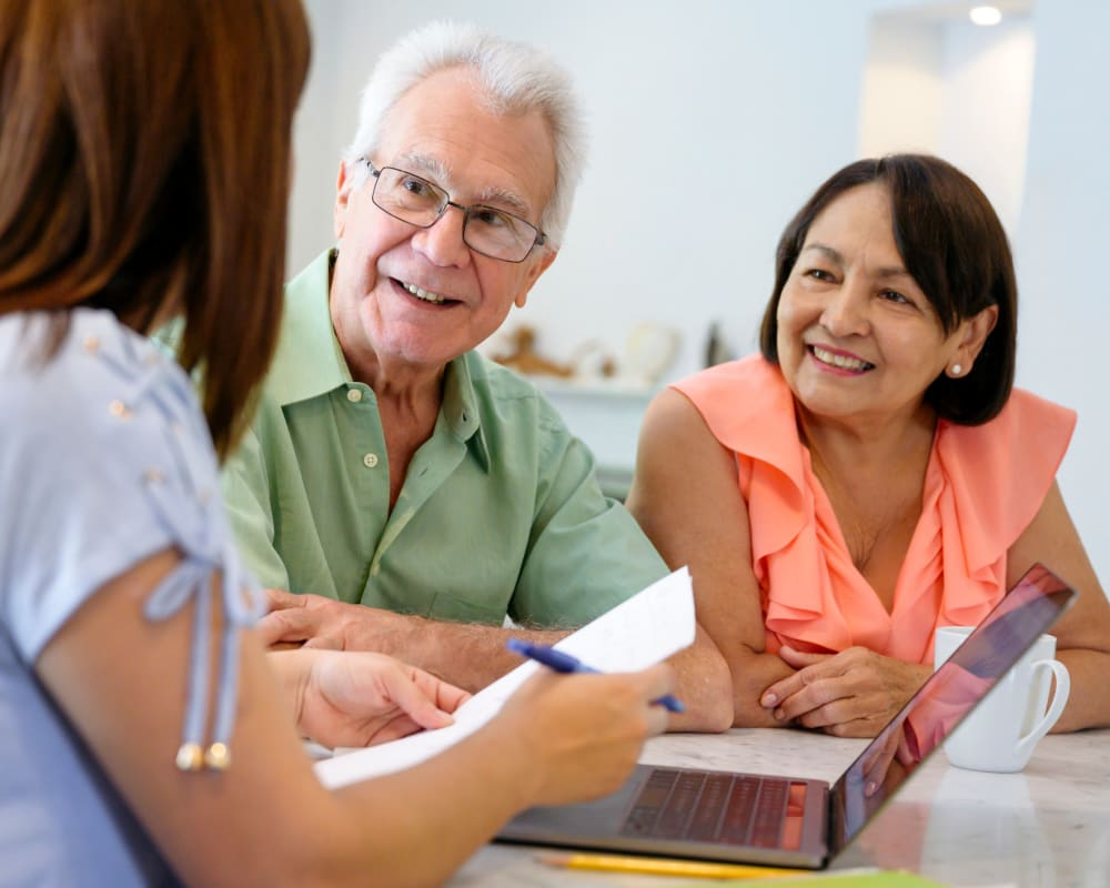 collaborative meeting between resident, family and staff members at Inspired Living at Sarasota in Sarasota, Florida.