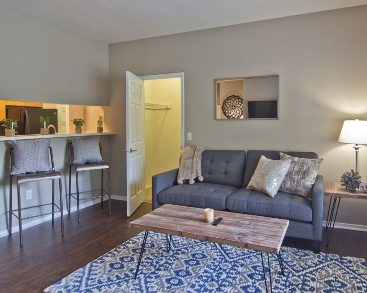 Bright, spacious living room at Perry's Crossing Apartments in Perrysburg, Ohio