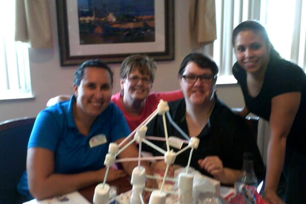 Marshmallow Tower team building activity at Discovery Senior Living in Bonita Springs, Florida