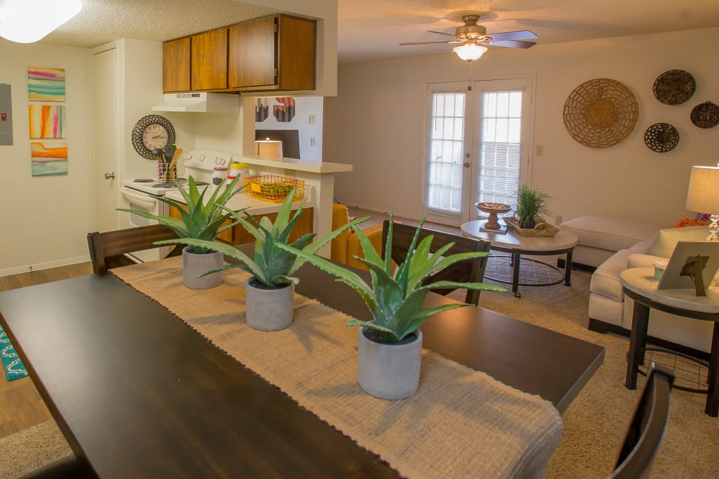 Dining room with a view of the living room at Cimarron Trails Apartments in Norman, Oklahoma