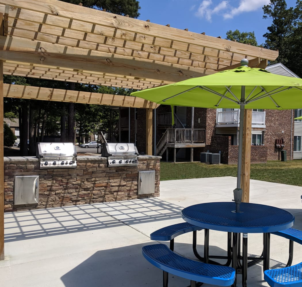 Exterior view of resident building and parking area at Residences at Sonoma Woods in Newport News, VA