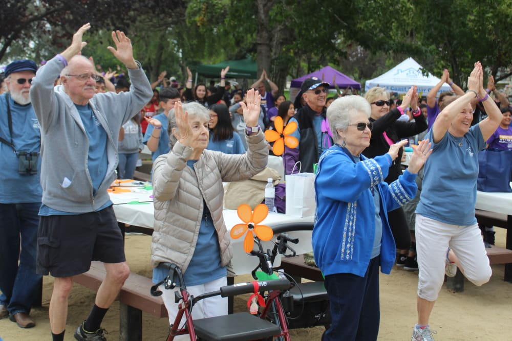 residents exercising together outside