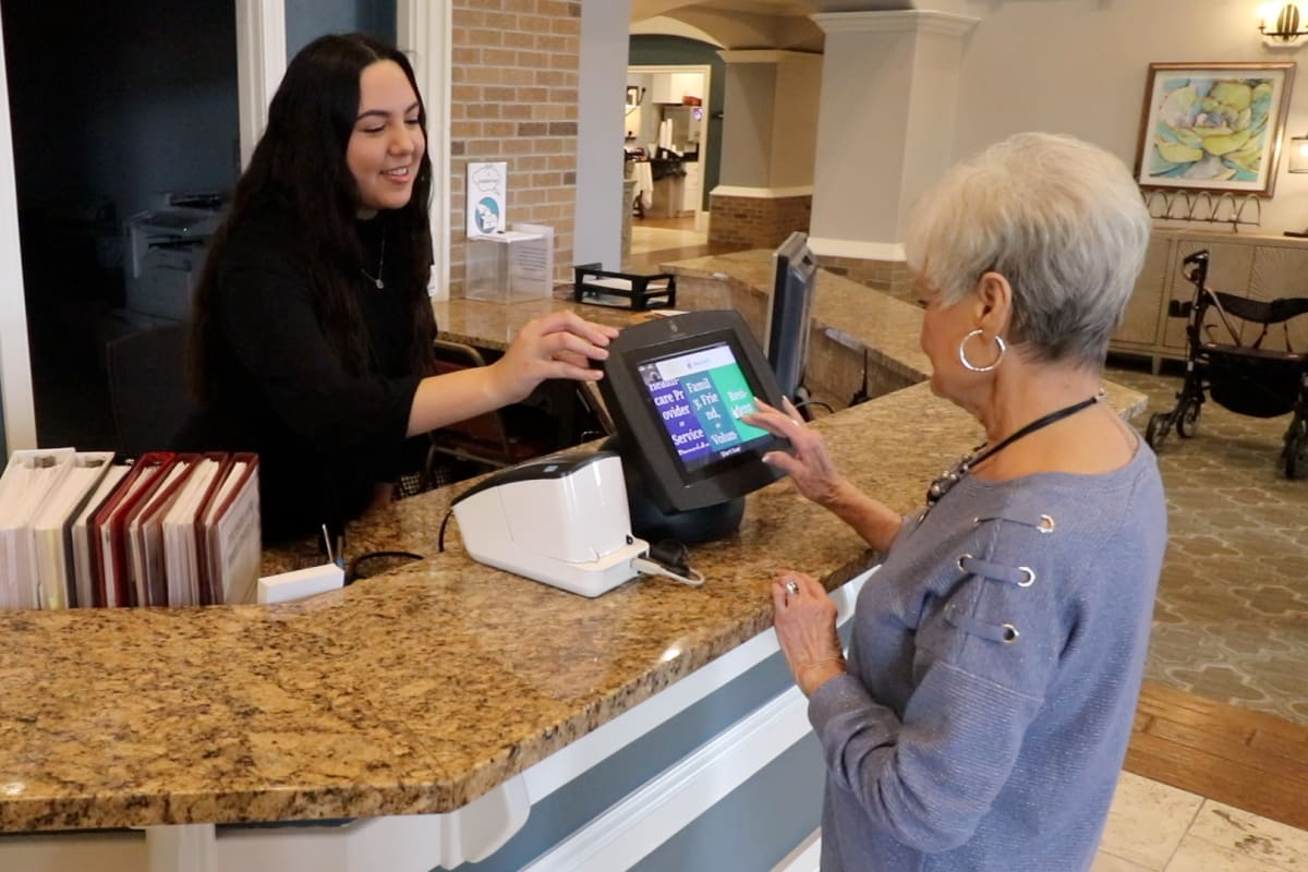 Staff member ringing up a resident at Watermere at the Preserve in North Richland Hills, Texas.