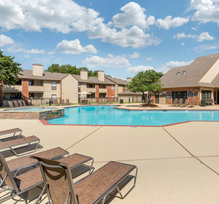 Swimming pool with a sundeck at The Logan in Bedford, Texas