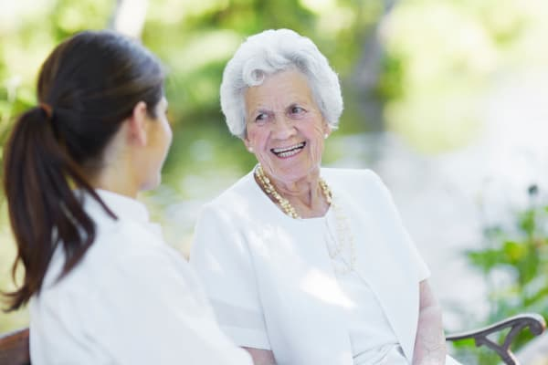 Resident talking to her daughter at Grand Plains in Pratt, Kansas