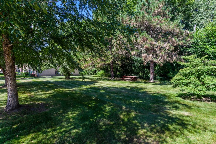 Lush grounds at Long Pond Gardens Senior Apartments in Rochester, New York