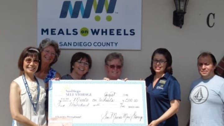 San Marcos Mini Storage presenting a check to Meals on Wheels