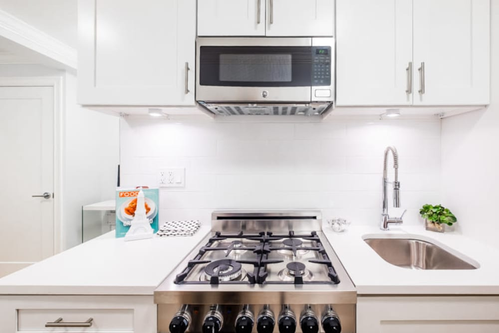 Kitchen with stainless-steel appliances at 210-220 E. 22nd Street in New York, New York