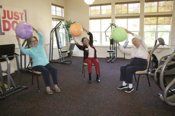 Residents in a group exercise class at Ashwood Meadows Gracious Retirement Living in Johns Creek, Georgia