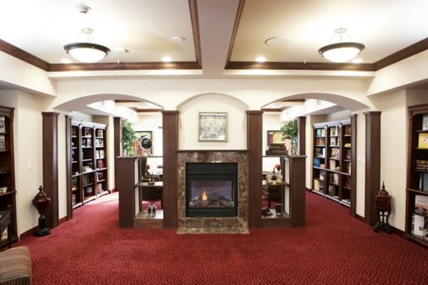 Fireplace in the library at Camden Springs Gracious Retirement Living in Elk Grove, California