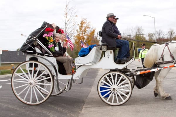 Two residents from Estrella Estates Gracious Retirement Living in Goodyear, Arizona in a horse drawn carriage