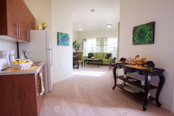 Kitchen and living room at Estrella Estates Gracious Retirement Living in Goodyear, Arizona