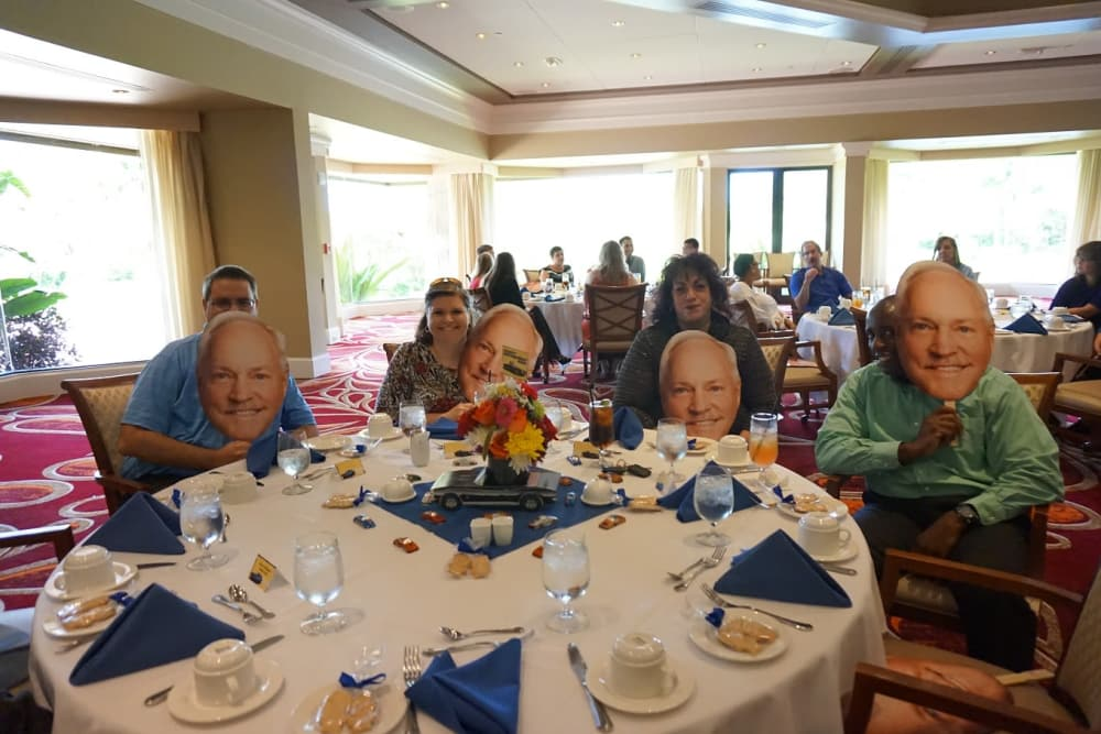 A table of people at a retirement party at Discovery Senior Living in Bonita Springs, Florida