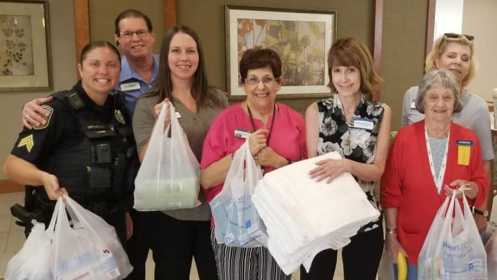 Community team with supplies for MG Carolina Park residents