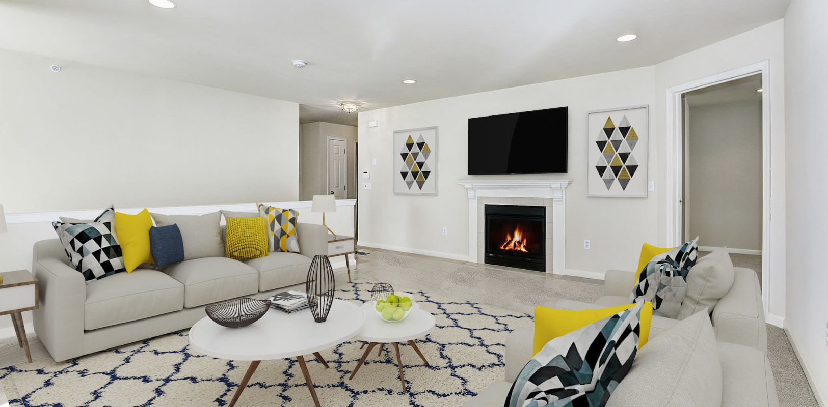 New plush carpeting and a fireplace in a model home's living area at Hanover Glen in Bethlehem, Pennsylvania